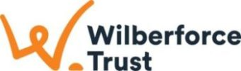 """Wilberforce Trust logo has an image of a person's head and arms on the left drawn in orange which also looks like the letter """"W"""". On the right hand side is """"Wilberforce Trust""""."""